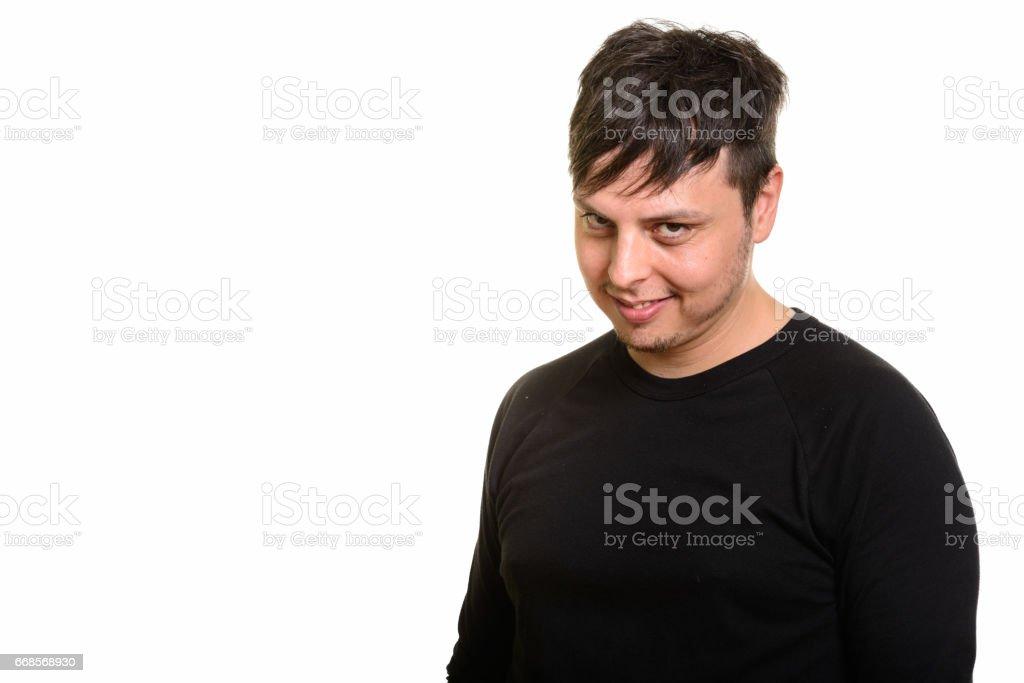 Studio shot of happy crazy man smiling stock photo