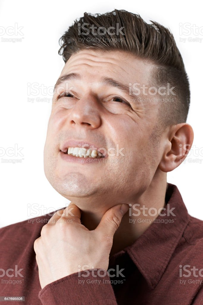 Studio Shot Of Man Suffering From Sore Throat stock photo