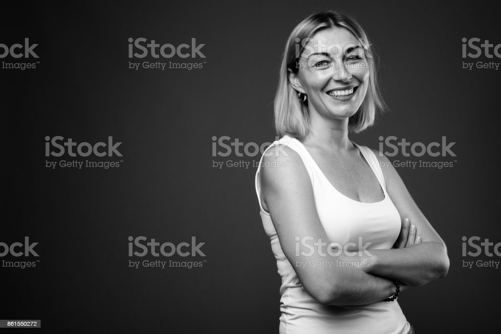 Studio shot of mature woman with short hair wearing tank top in black and white stock photo