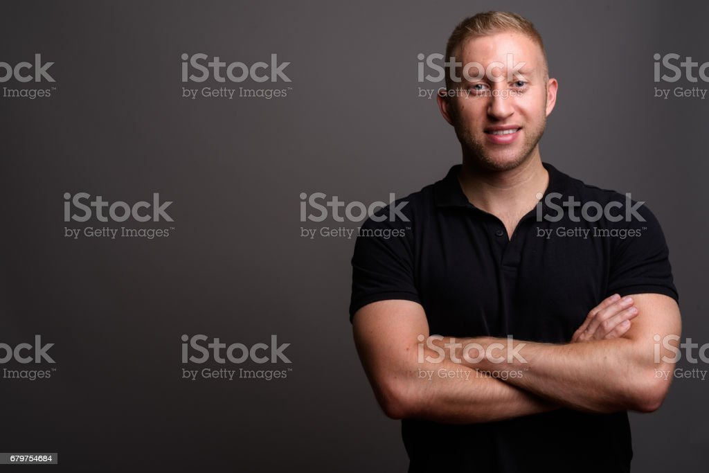 Studio shot of muscular man against gray background stock photo