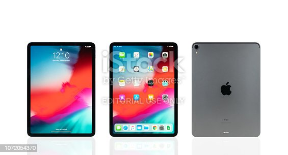 istock Studio shot of new Apple iPad pro 2018 space gray color, display home and lock screen and logo on back. Isolate on white background 1072054370