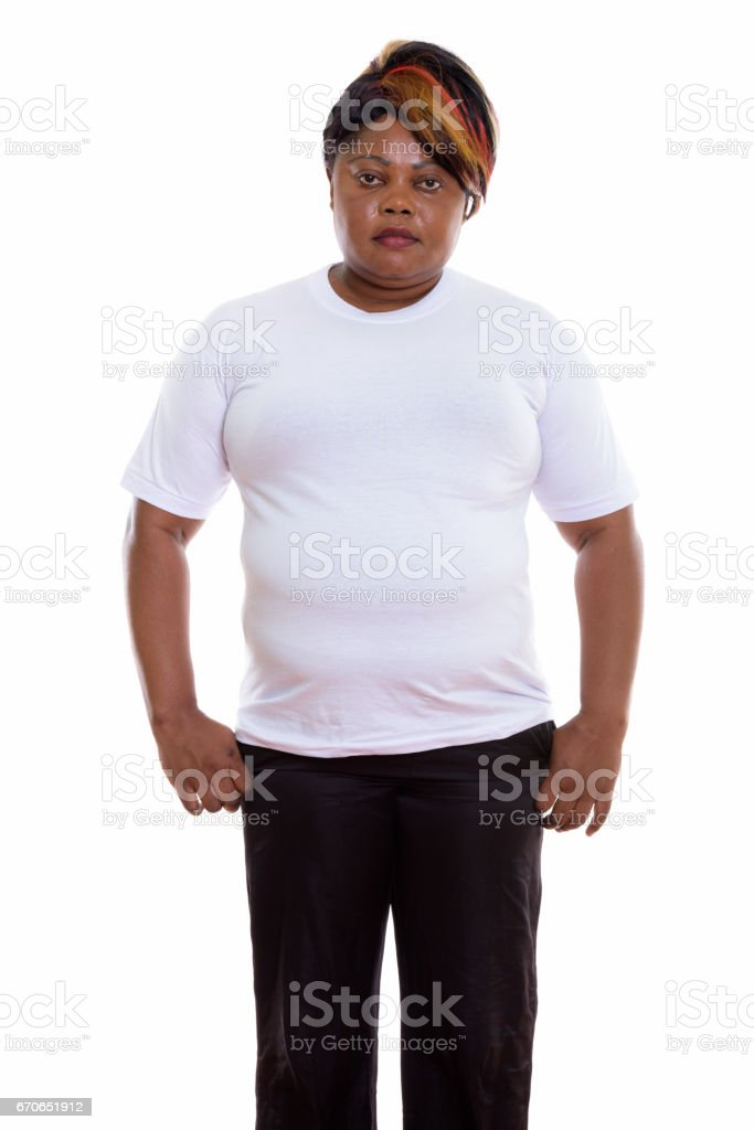 Studio shot of fat black African woman standing ready for gym stock photo