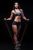 istock studio shot of perfect body bodybuilder female with expander; 590301282