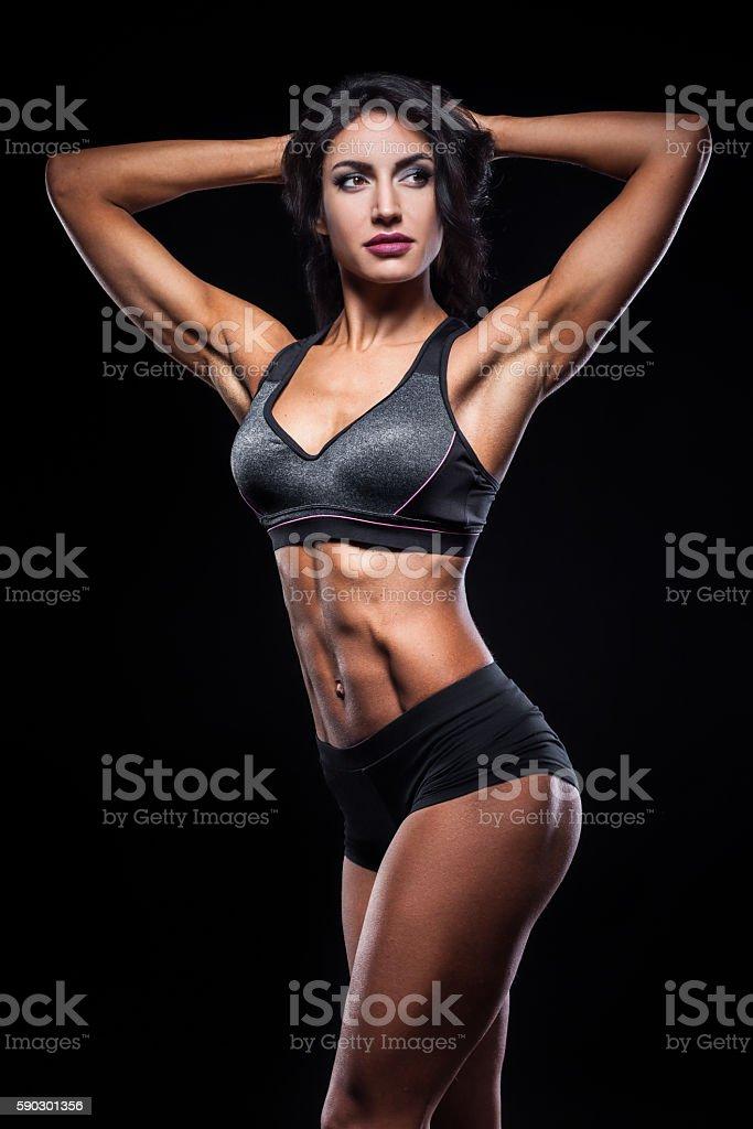 studio shot of perfect body of bodybuilder female; royaltyfri bildbanksbilder