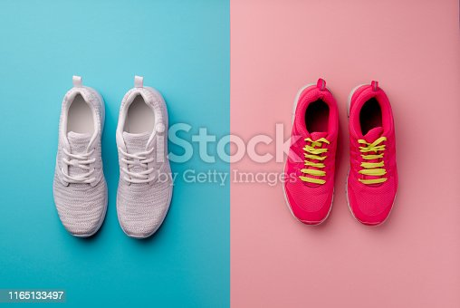 A studio shot of running shoes on bright color background. Flat lay, top view.