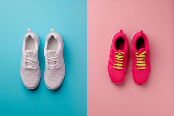 a studio shot of running shoes on bright color background. flat lay. - but sportowy zdjęcia i obrazy z banku zdjęć