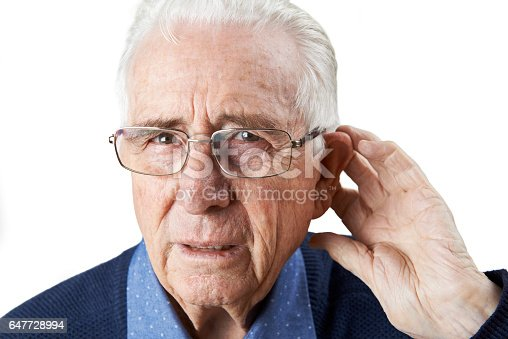 1029343276 istock photo Studio Shot Of  Senior Man Suffering From Deafness 647728994