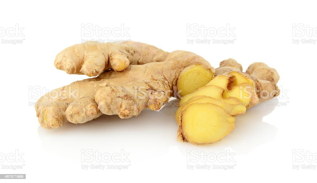Studio shot of sliced ginger isolated on white stock photo