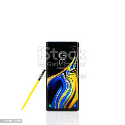 Bangkok, Thailand - Sep 10, 2018: Studio shot of the new Samsung Galaxy Note 9 smartphone in ocean blue color with yellow S-Pen stylus, isolated on white background. Illustrative editorial content.