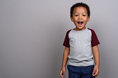 istock Studio shot of young African boy against gray background 679806362