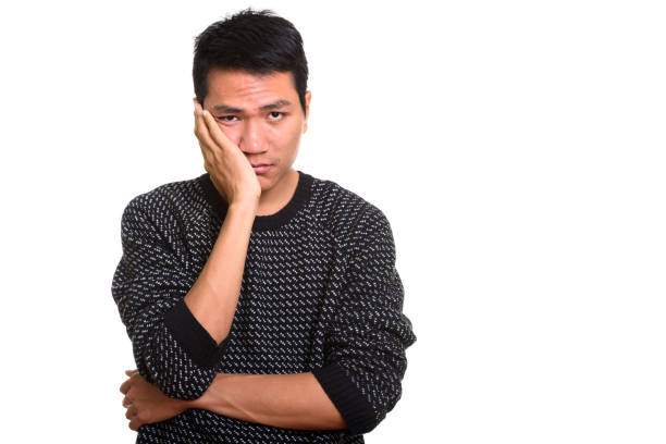 studio shot of young asian man looking stressed - frustrated man stock photos and pictures