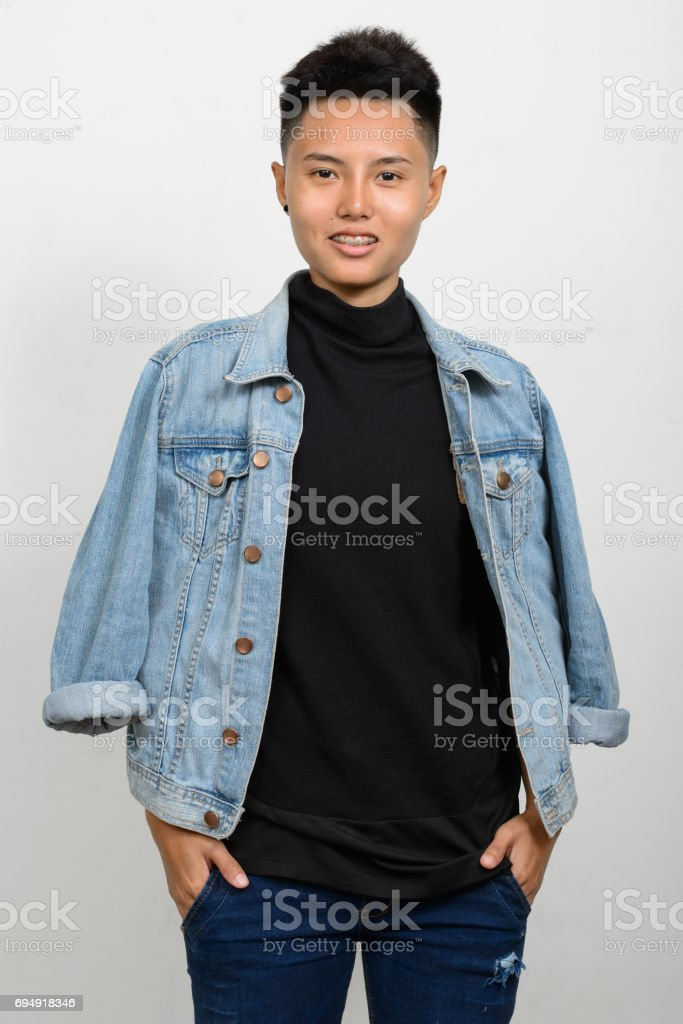 Studio shot of young Asian woman with short hair against white background stock photo