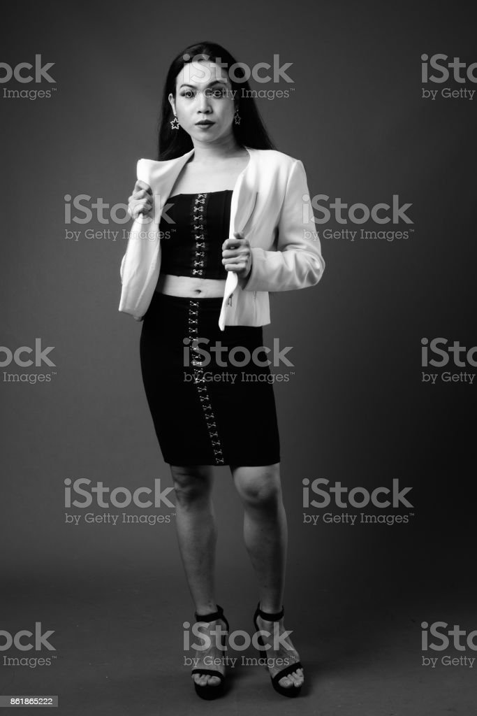 a6aeff7c5a Studio shot of young beautiful Asian transgender businesswoman in black and  white - Stock image .