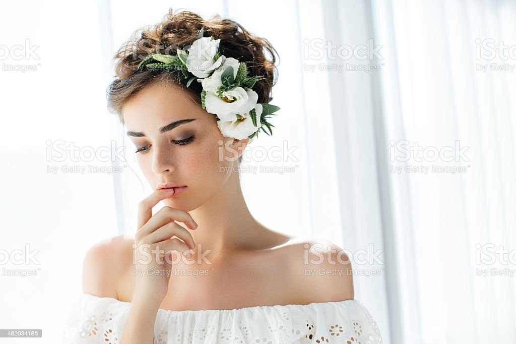 Studio shot of young beautiful bride on light background stock photo