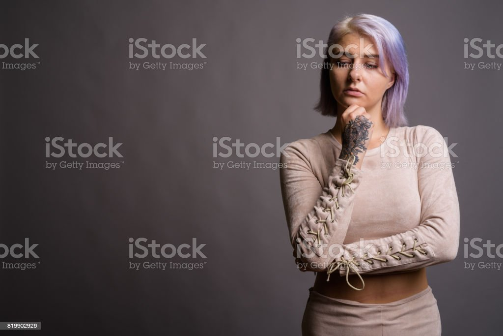 Studio Shot Of Young Beautiful Rebel Woman With Colorful Hair