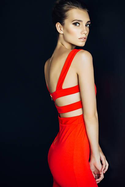 Studio shot of young beautiful woman on dark background stock photo