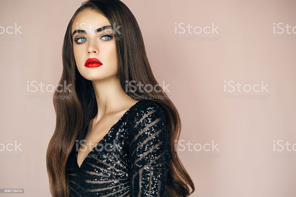 Studio shot of young beautiful woman on light background stock photo