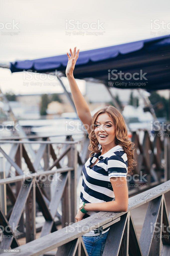 Studio shot of young beautiful woman on the berth stock photo