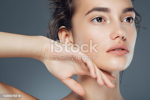 istock Studio shot of young beautiful woman 1035978318