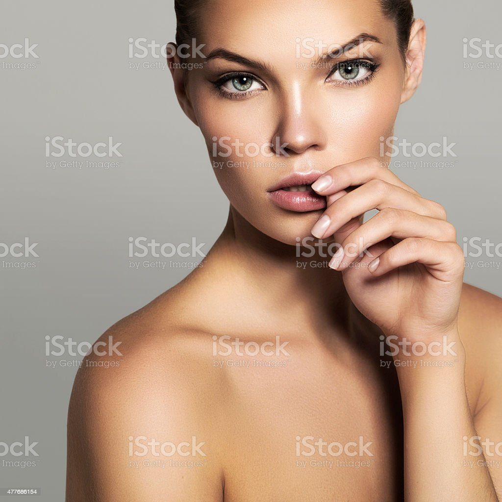 Studio shot of young beautiful woman stock photo