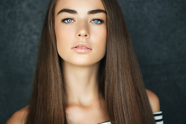 Studio shot of young beautiful woman Outdoor shot of young beautiful woman straight hair stock pictures, royalty-free photos & images