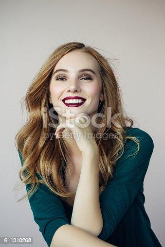611310330istockphoto Studio shot of young beautiful woman 611310268