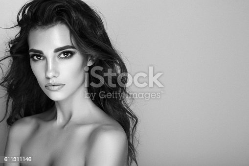Studio shot of young beautiful woman. Professional make-up and hairstyle.