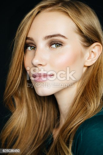 611310330istockphoto Studio shot of young beautiful woman 625036450