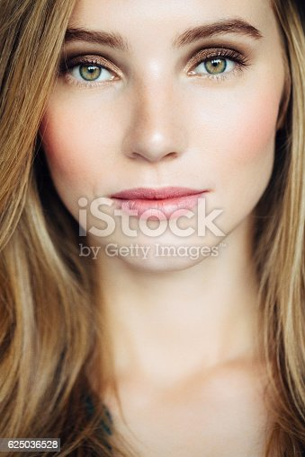 611310330istockphoto Studio shot of young beautiful woman 625036528