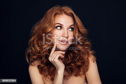 611310330istockphoto Studio shot of young beautiful woman 999805364
