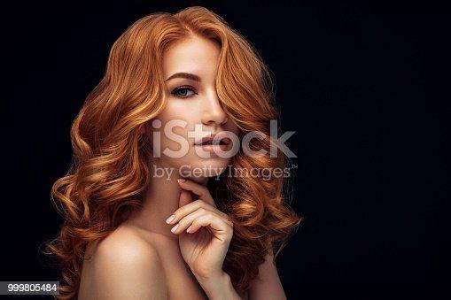 611310330istockphoto Studio shot of young beautiful woman 999805484