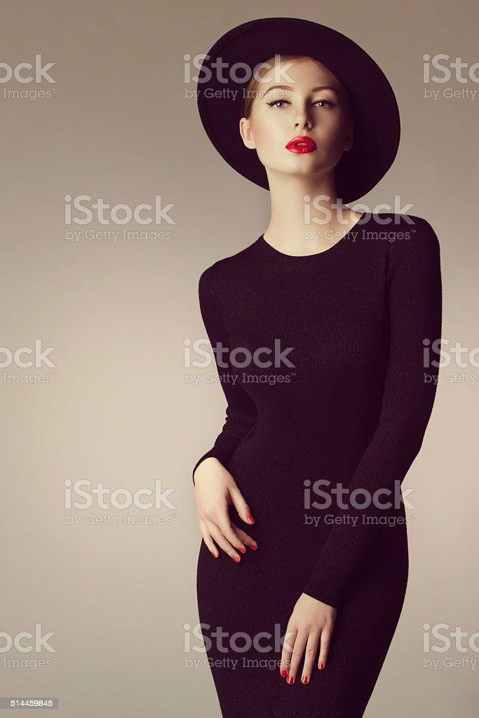 Studio shot of young beautiful woman wearing retro hat stock photo