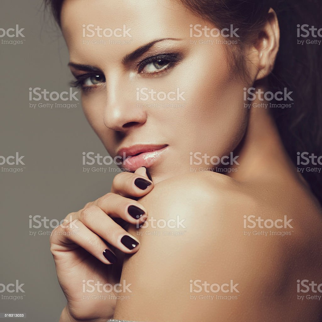 Studio shot of young beautiful woman with perfect hairstyle stock photo
