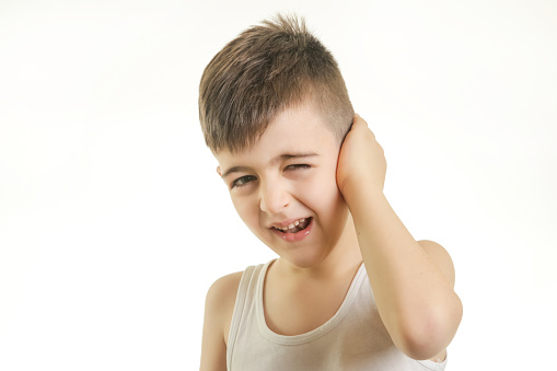 istock Studio shot of young boy with ear pain. Can not hear you concept. 903480044