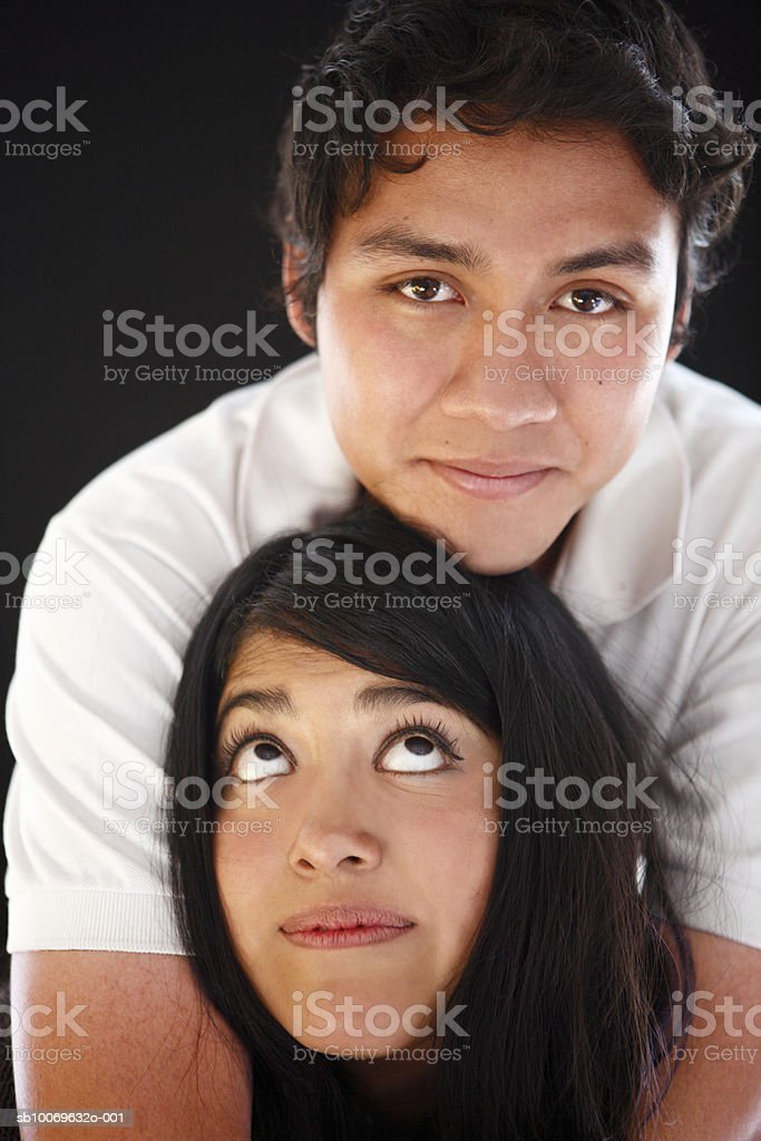 Studio shot of young couple being affectionate foto de stock libre de derechos