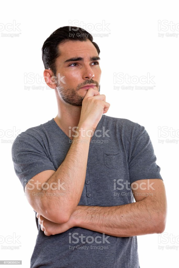 Studio Shot Of Young Handsome Man Thinking With Hand On Chin Stock