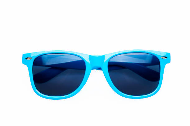 studio shot on white background: blue sunglasses - man made object stock photos and pictures