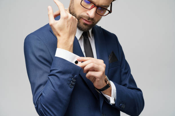 studio shot stylish businessman wearing suit and watches stock photo