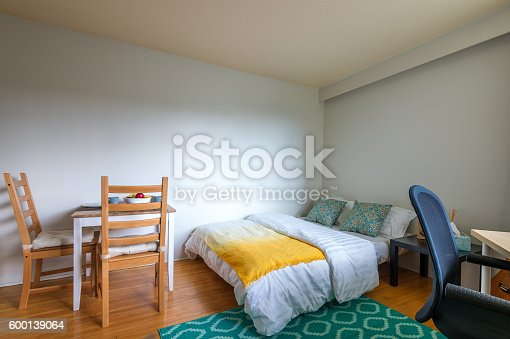 istock Studio student apartment with a dining room, bedroom, and office. 600139064