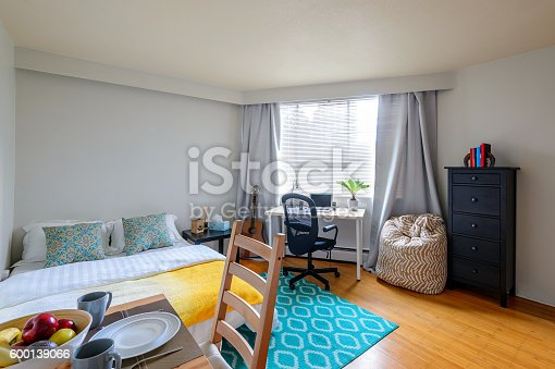 istock Studio student apartment with a dining room, bedroom, and office. 600139066