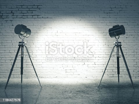 Studio with blank brick wall and professional lighting equipment. Mock up, 3D Rendering