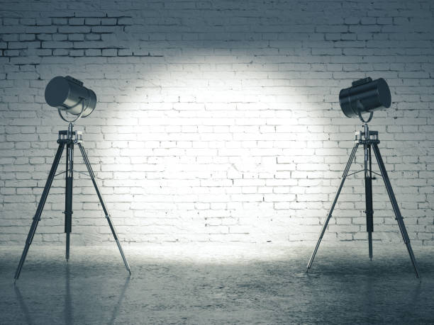 Studio with lighting equipment Studio with blank brick wall and professional lighting equipment. Mock up, 3D Rendering spot lit stock pictures, royalty-free photos & images
