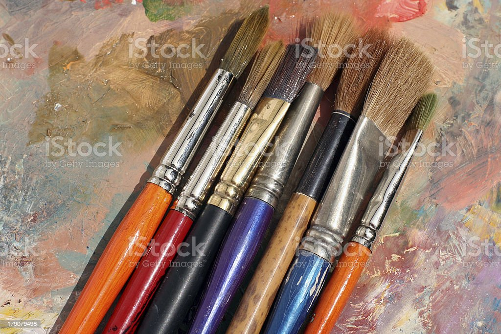 studioArt paint palette and brushes royalty-free stock photo