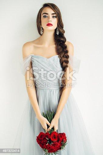 istock Studioshot of young beautiful woman 497320414