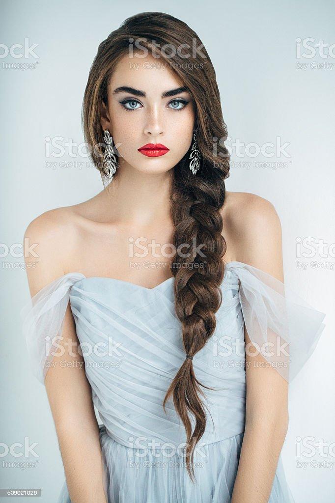 Studioshot of young beautiful woman stock photo
