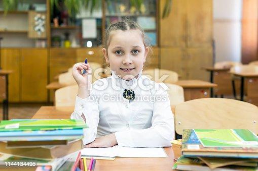 istock Studious girl schoolgirl in a white blouse. 1144134495