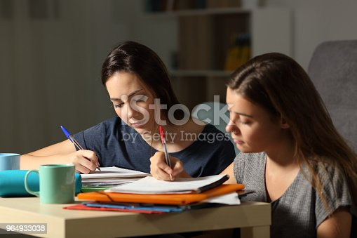 820495452 istock photo Studious students studying hard in the night 964933038