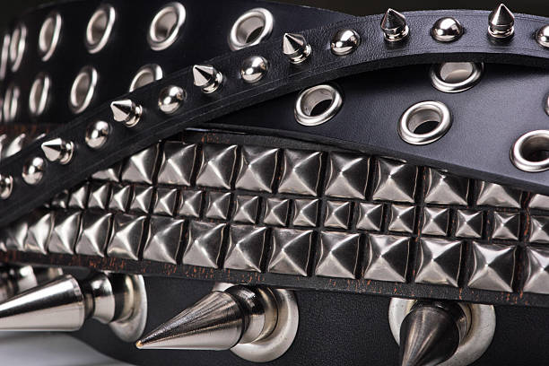 studs-n-spikes Belts with studs and spikes on them tangled together.Another punk themed belt: spiked stock pictures, royalty-free photos & images