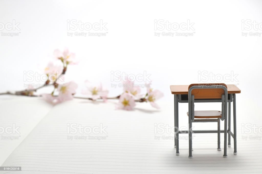 Study desk and cherry blossoms. stock photo