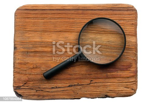 istock Study of wood texture through a magnifying glass, isolated 1057554354